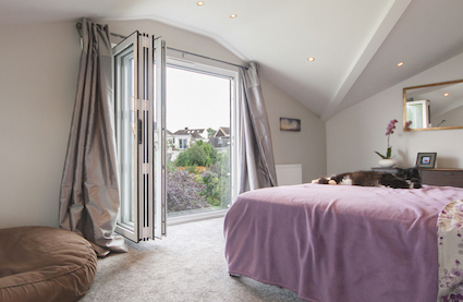 boudoir style loft conversion bedroom with bifold doors