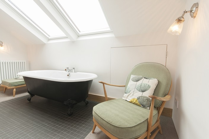 freestanding bath in a loft conversion bathroom, alternative is a wet room shower room for a luxury look in a smaller space