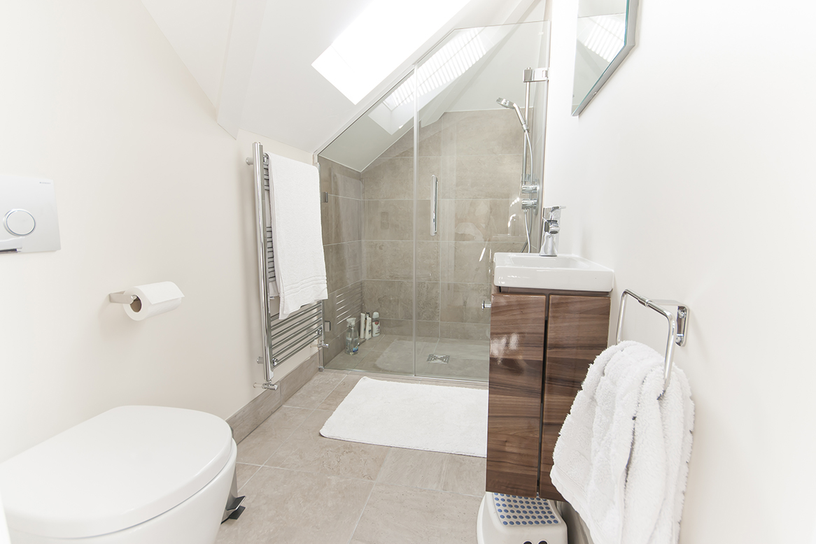 Loft conversion shower room wet room with Velux window