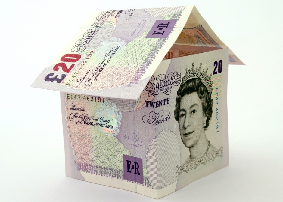 Photo of two twenty pound notes, one folded to represent two sides of a square, the other folded and placed on top as a triangle to represent the roof, and loft space, of a house.