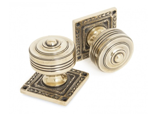 Pair of ornate antique brass door knobs
