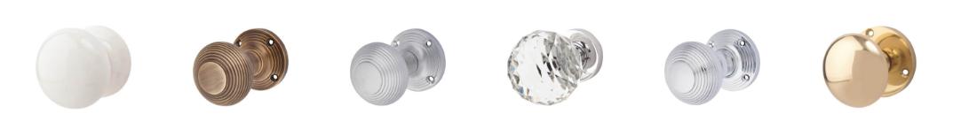 Horizontal image of six different door knobs