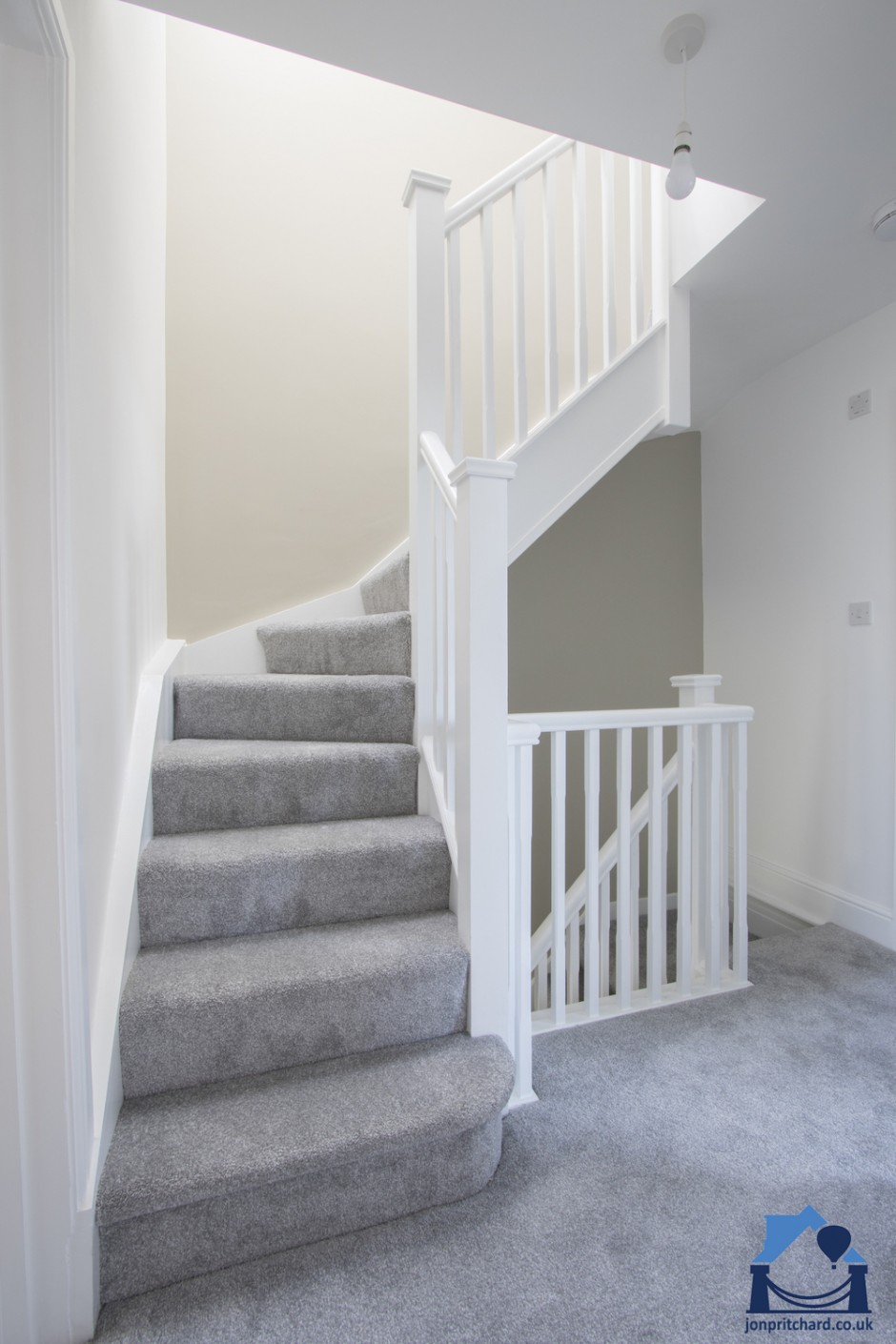Loft conversion staircase, Full size, Light grey carpet and white painted modern square spindles, handrails etc