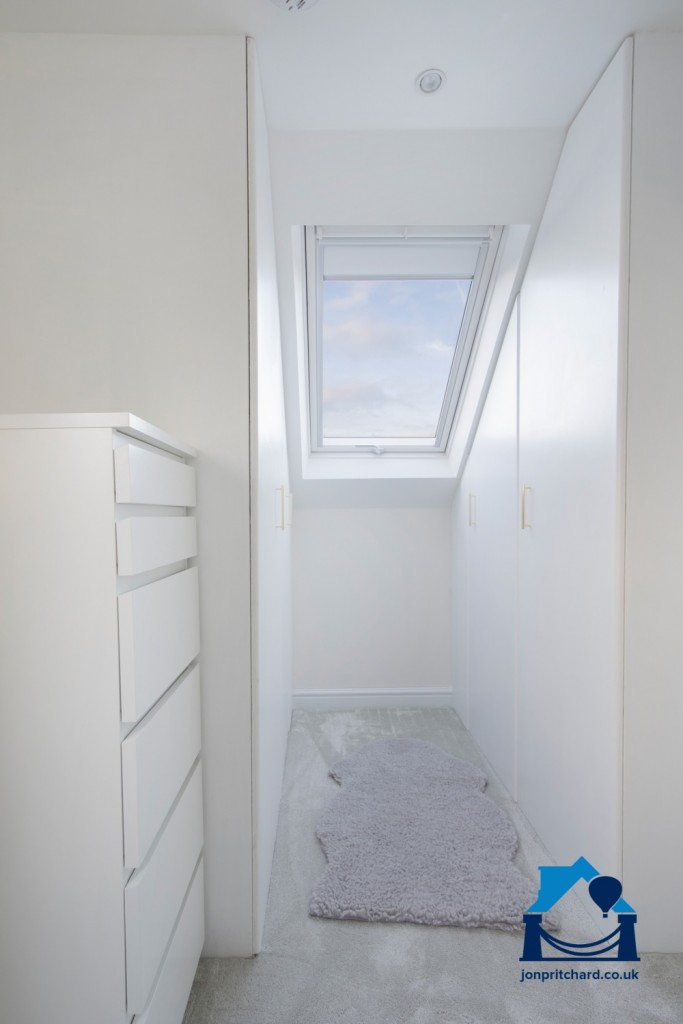Image showing custom fitted wardrobes in a loft conversion.