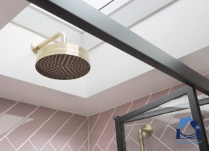 Loft conversion shower head installed in the skylight recess for extra height